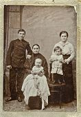 RUSSIA - CIRCA 1903: Old photo printed in Russia shows family: grandmother, mother, father, two children, circa 1903