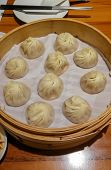 Chinese Steamed Steamed Bun (baozi) Named Xiaolongbao Also Called A Soup Dumpling. It Is Traditional poster