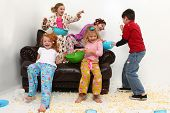 stock photo of slumber party  - Food fight with brother at girl - JPG