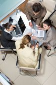 foto of business-partner  - View from above of successful business partners sitting at table and interacting - JPG