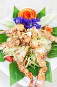 Thai seafood, crap salad with flower decoration