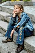 Girl Sitting On The Staircase