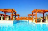 Luxury Swimming Pool And Pergola In Resort Hotel