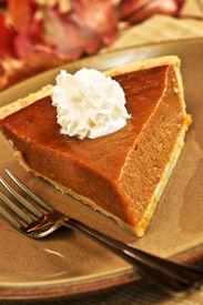 picture of pumpkin pie  - Slice of pumpkin pie with fresh whipped cream - JPG