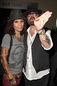LOS ANGELES - JUL 12:  Linda Perry, Dave Stewart at the  Dave Stewart: Jumpin' Jack Flash & The Suicide Blonde Photography Exhibit at the Morrison Hotel Gallery on July 12, 2013 in West Hollywood, CA