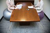 Businesswomen sitting on exercise balls in meeting