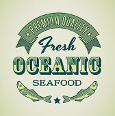 Retro-styled seafood label including images of fish. Editable vector.
