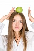 Girl With Green Apple On Her Head