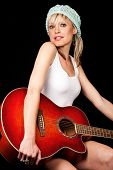 Gorgeous Young Woman Holding A Guitar
