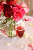 Bouquet Of Roses And Glass Of Champagne