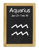 the zodiac sign Aquarius on a blackboard