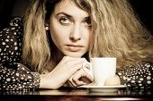 Close-up Portrait Of Beautiful Young Woman Drinking Coffee