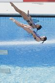 ROME, ITALY - JULY 24 2009; Rome Italy; Jingjing Guo and Minxia Wu (CHN) competing in the women's sy