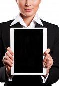 A young businesswoman holding her digital tablet pc (white background)