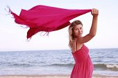 Pregnant Woman With A Scarf On The Beach