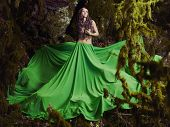 Beautiful nymph in the fairy forest. Fashion photo