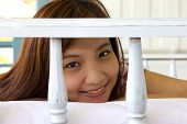 Closeup Happiness Woman's Face In Daybed At Balcony