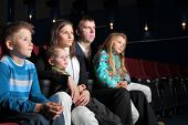 Family watching a movie in the cinema.