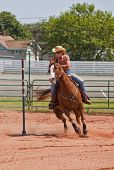 pic of barrel racer  - Western horse and rider competing in pole bending and barrel racing competition - JPG