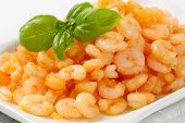 plate of peeled shrimps with basil