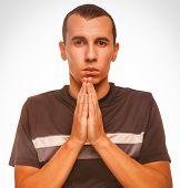 man brunette prays Christianity hands together