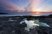 Sunset Over A Tidal Pool . Rocky Coast Of Scotland .