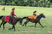 History Fans Dressed As 17Th Century Polish Gentry Ride On Horseback