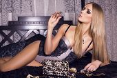image of silk lingerie  - beautiful woman  with blond hair in lingerie with gewelry - JPG