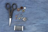 Sewing Kit On Jeans Background, Copy Space.