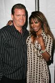 John Edward Yarbrough and Traci Bingham at the Gen Art 9th Annual Fresh Faces in Fashion event, Barker Hanger, Santa Monica, CA 10-13-06