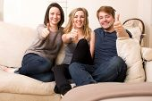 Three Enthusiastic Teenagers Giving A Thumbs Up