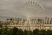 Ferris Wheel (roue De Paris) On The Place De La Concorde From Tuileries Garden. Ferris Wheel Was Ins
