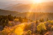 Autumn Sun Flares across an Autumn Scenic of the Southern Appalachian Mountains