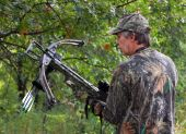 Camouflaged Crossbow Hunter