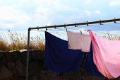 Clothes Hanging To Dry On A Laundry Line