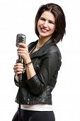 Half-length portrait of rock singer wearing leather jacket and keeping static mic, isolated on white