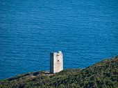 stock photo of gibraltar  - Old abandoned watchtower and signal tower on the coast of the Starit of Gibraltar - JPG
