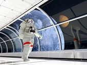 Astronaut walking on glass corridor.