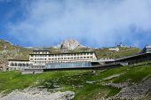 ALPNACHSTAD, SWITZERLAND - July 3, 2014: The Hotel Pilatus-Kulm, first opened in 1890, stands atop  Mount Pilatus in the Swiss Alps. Viewed from the Pilatus-Bahn cogwheel train.