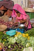 Indian Woman Sells Vegetables In The Market