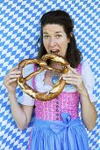 Woman In Dirndl With Pretzel