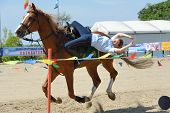 LYTKARINO, MOSCOW REGION, RUSSIA - JULY 12, 2014: Julia Lysenko from Moscow police performs stunts during Russian championship in trick riding. Lytkarino housed the Russian Federation of trick riding