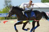 LYTKARINO, MOSCOW REGION, RUSSIA - JULY 12, 2014: Maria Kholodova performs stunts during Russian championship in trick riding. Lytkarino housed the Russian Federation of trick riding