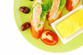 picture of butter-lettuce  - salmon pieces on baguette slices with butter and olives - JPG