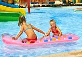 foto of inflatable slide  - Child on water slide at aquapark - JPG
