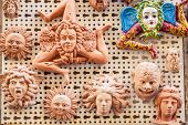 stock photo of triskelion  - group of different sicilian souvenirs sold in a store - JPG