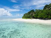 stock photo of malaysia  - The white sand and turquoise colored waters of idyllic Pulau Sipadan island in Sabah East Malaysia - JPG