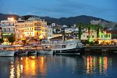 MARMARIS, TURKEY - MAY 15, 2014: Trip boats moored on the embankment in the night. Boat trips are lo