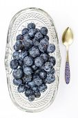 Fresh Blueberries In Oval Glass Dessert Bowl And Spoon