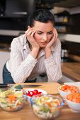 Depressed Young Woman In Kitchen